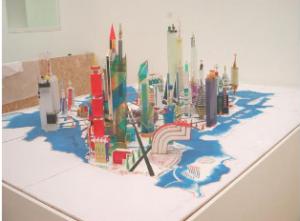 Body Isek Kingelez , Project for the Kinshasa III e millennium 1997 Wood, paper, cardboard 100 x 332 x 332 cm Courtesy Cartier Foundation for Contemporary Art, Paris