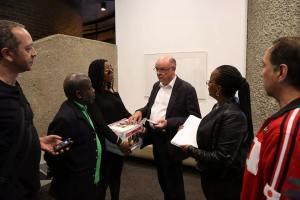 Sara Myers delivers the petition to Sir Nicholas Kenyon at the Barbican. 16/09/14. Photograph: © Thabo Jaiyesimi.