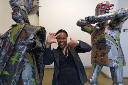 Artist Sokari Douglas Camp with two sculptures from the artwork 'Dressed to the Nines'. Photographer: Nate Boguszewski. Source: http://nbog.us/zewski/blogski/2012/10/light-moment-sokari-douglas-camp