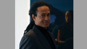 British artist Kimathi Donkor pictured in front of his painting Andromeda (2011). Source: InIVA [http://www.iniva.org/]