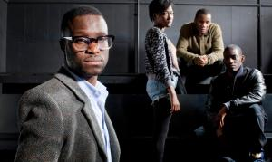 Femi Oguns (left), the founder and CEO of the Identity Drama School in Hackney with three of his students. Photograph: David Levene/The Guardian