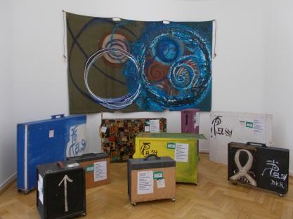 Packing crates and tarpaulin painted by El Hadji Sy.