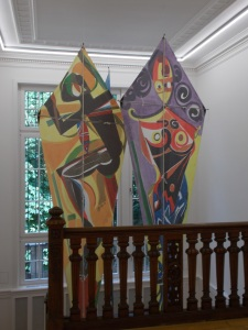 Kites painted by El Hadji Sy in 1994, positioned above the staircase at the Weltkulturen Museum.
