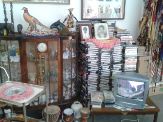 """Items displayed in the """"front room"""" of the Vanley Burke installation."""