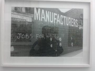 Street photography by Vanley Burke showing racist graffiti.