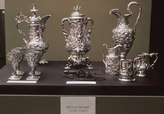 Fred Wilson's installation 'Mining the Museum' (Maryland Historical Society, 1992) which features branding irons and other instruments of torture in display cabinets with ornately decorated silver – labelled 'Metalwork 1793-1880.'