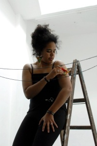 """A still from the performance installation """"Planting Present Tense"""" by Nathalie Mba Bikoro (Berlin, 2015). Source: http://www.nbikoro.com."""
