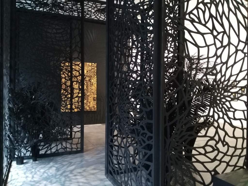 'The Black Ark' (2017-19) on display in Gallery 1: Dark Continent (2015-19). The artwork 'Constellations IX' (2019) can also be seen on the back wall, featuring a maze of coded gold symbols. Photo: Carol Dixon.